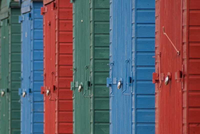 Photography composition using repetition of locks on beach huts