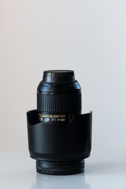 Nikon 24-70mm lens with lens hood stored