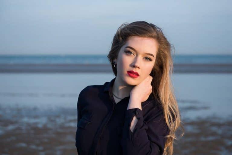 Model on the beach at sunset demonstrating focus lock