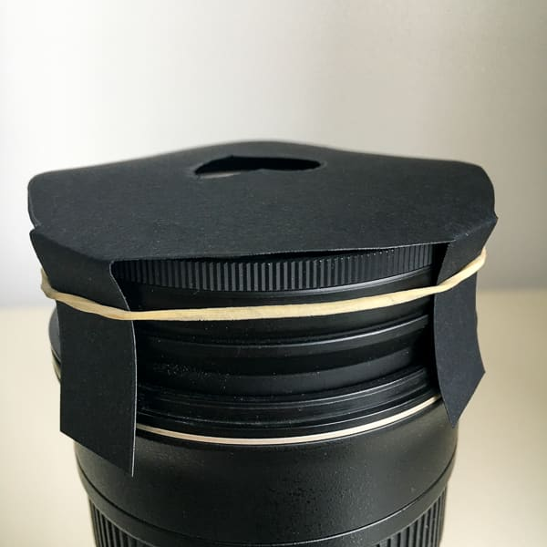 DIY bokeh filter fitted to lens with elastic band