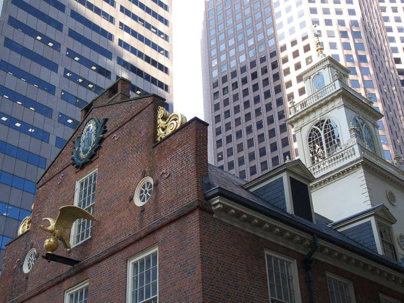 Juxtaposition of old building versus new modern buildings
