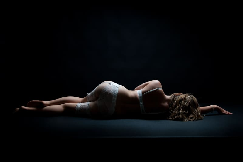 Shadows in boudoir photography for mystery